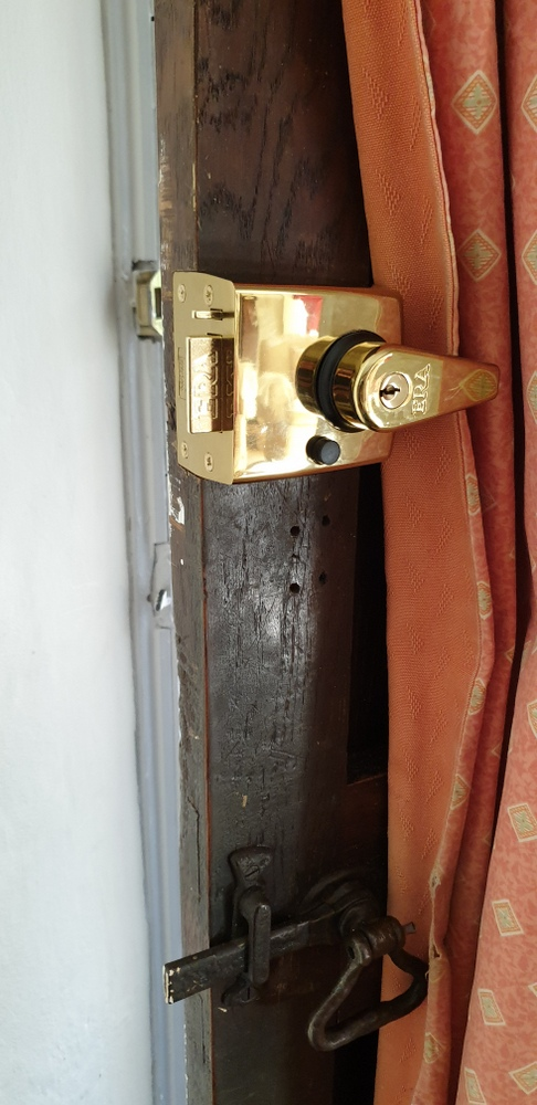 Gold yale lock on door