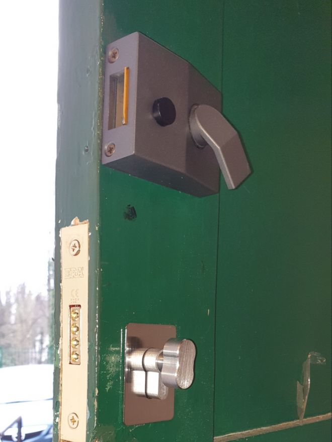 Night latch fitted on door